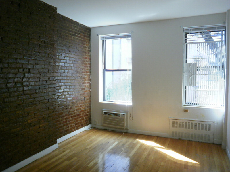 EXPOSED BRICK STUDIO IN ELEVATOR BUILDING WITH VIDEO DOOR INTERCOM