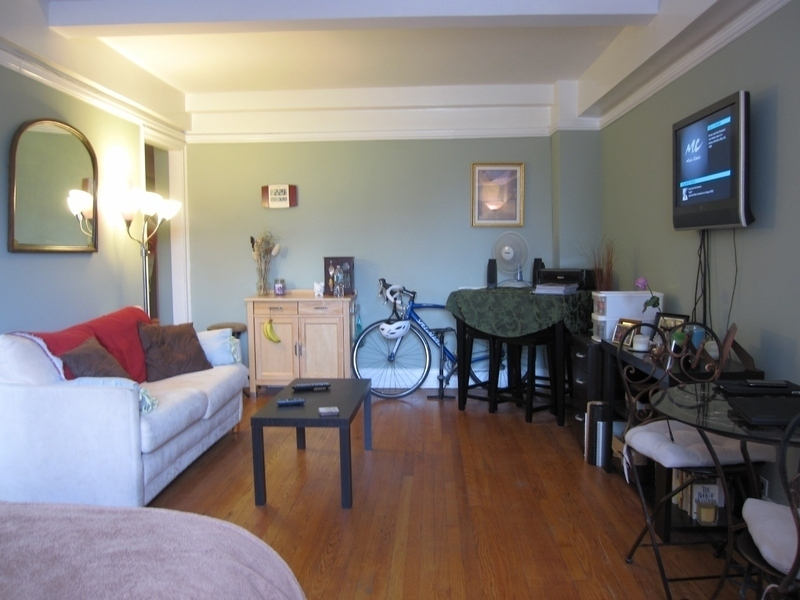 LARGE studio with Beautiful Pre-War details in full svc elev building!