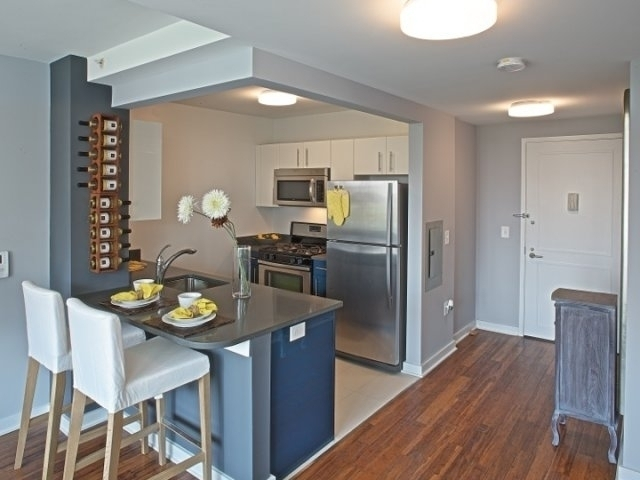 Lavish 1 Bed/1 Bath in East Village w/ Balcony, Roof-Top Sky Deck & Package Room - No Fee
